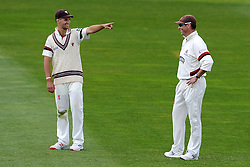Somerset's Lewis Gregory and Marcus Trescothick share a joke in the outfield. - Photo mandatory by-line: Harry Trump/JMP - Mobile: 07966 386802 - 13/04/15 - SPORT - CRICKET - LVCC County Championship - Day 2 - Somerset v Durham - The County Ground, Taunton, England.