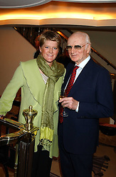 SIR PETER O'SULLEVAN and CLARE BALDING at The Sir Peter O'Sullevan Charitable Trust Lunch at The Savoy, London on 23rd November 2005.<br />