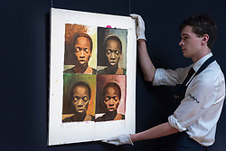 "© Licensed to London News Pictures. 23/03/2018. LONDON, UK. A technician hangs ""A La Warhol"", by Njideka Akunyili Crosby (Est. GBP50,000-70000).  Preview of Modern and Contemporary African Art sale at Sotheby's, New Bond Street.  The auction will take place on 28 March 2018.   Photo credit: Stephen Chung/LNP"