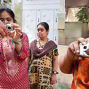 Can you feel how energetic the women are for the first time getting touch of the camera?