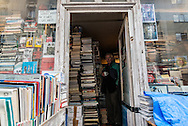 France. Paris 14th . Bookseller in his overcrowded book store rue Boulard