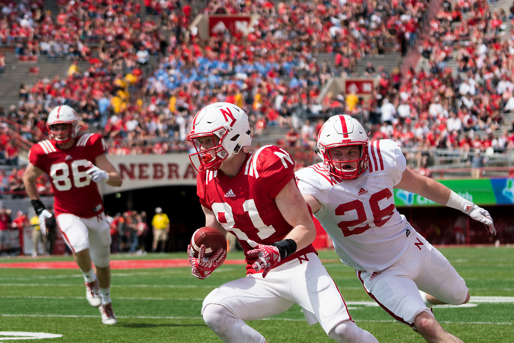 Nebraska Cornhuskers wide receiver Gabe Rahn #81 is tackled by Thomas Connely #26 during Nebraska's annual Red/White Spring Game at Memorial Stadium on April 15, 2017. Photo by Paul Bellinger, Hail Varsity