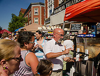 Jim McCauley from the Big Cat Coffee booth serves up frozen Chai during Saturday's Coffee Festival in downtown Laconia.  (Karen Bobotas/for the Laconia Daily Sun)