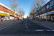 A deserted main shopping street in Oadby Town centre Shops, bars, pubs, closures due to the Covid_19 Coronavirus in Oadby Leicester, United Kingdom on 22 March 2020.