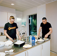 Halden Prison, Norway, June 2014:<br /> Inmates named Reijo (left) and Yassin with cake that Yassin made for another inmate's birthday. The cake is called Kv&aelig;fjord kake, a favorite confection of spongecake, custard, and meringue topped with almonds and whipped cream known to Norwegians as the &ldquo;World&rsquo;s Best [Cake].&rdquo;<br /> -- No commercial use --<br /> Photo: Knut Egil Wang/Moment/INSTITUTE