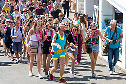© Licensed to London News Pictures. 27/05/2018. Brighton, UK. Members of the public dance on Brighton and Hove promenade as they listen to music on their headphones, known as a silent disco as sunny and hot weather is hitting the seaside resort on the Bank Holiday weekend Sunday. Photo credit: Hugo Michiels/LNP
