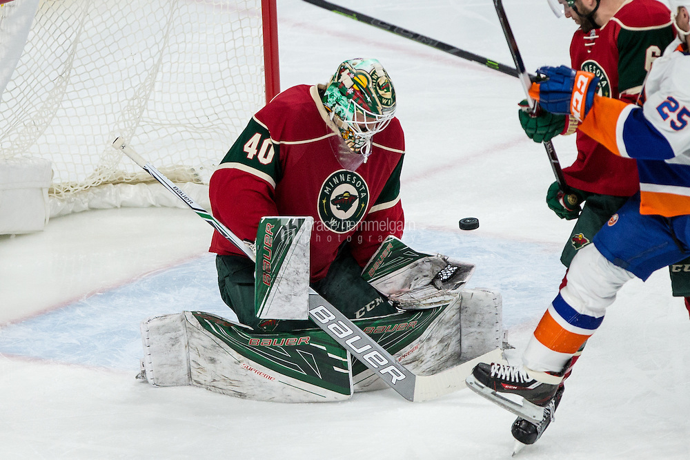 Dec 29, 2016; Saint Paul, MN, USA; Minnesota Wild goalie Devan Dubnyk (40) makes a save during the third period against the New York Islanders at Xcel Energy Center. The Wild defeated the Islanders 6-4. Mandatory Credit: Brace Hemmelgarn-USA TODAY Sports