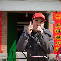An Evangelical university student delivers an impassioned sermon to a village audience.  Much of the sermon is focused the materialism and greed of modern Chinese society. Proselytizing is illegal in China but groups like this are testing the government's determination to enforce this law.