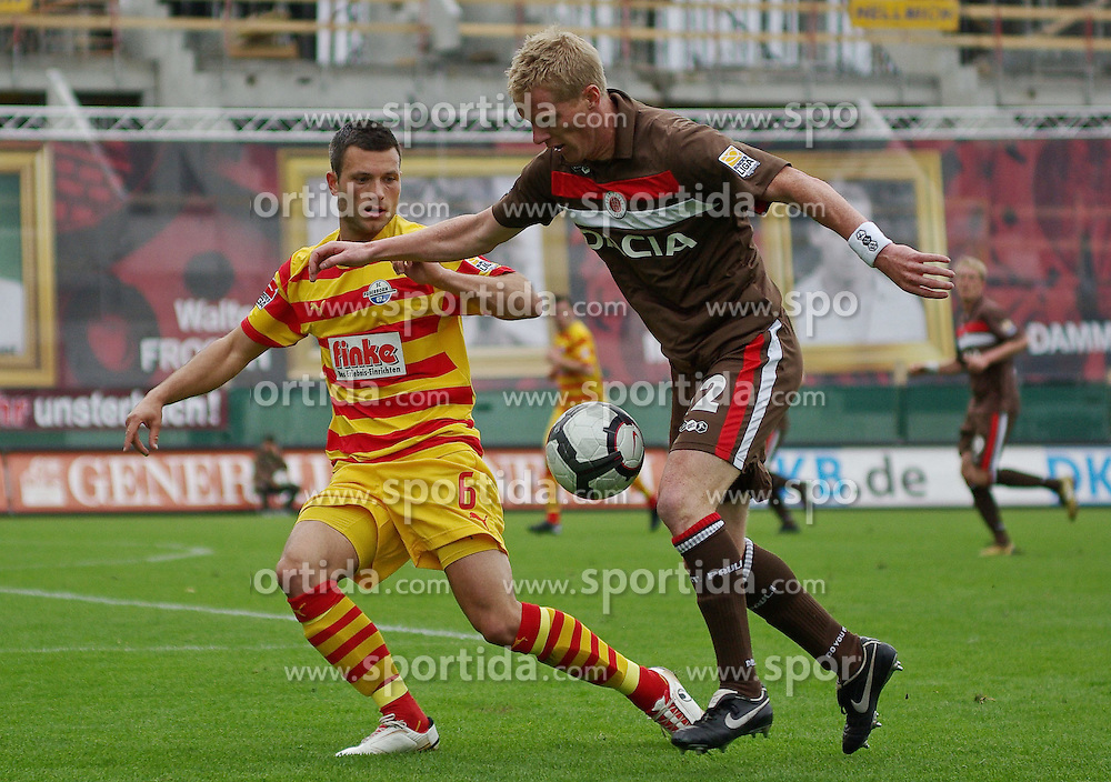 09.05.2010, Millerntor-Stadion, Hamburg, GER, 2. FBL, FC St. Pauli vs SC Paderborn 07, im Bild Florian Mohr (Paderborn #6, links), Timo Schultz (St. Pauli #12, rechts)   EXPA Pictures © 2010, PhotoCredit: EXPA/ nph/  Frisch / SPORTIDA PHOTO AGENCY