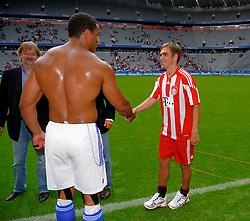 FC Bayern Munich v Fitness First Winter stars, Adjei Richard left dwarfs Philipp Lahm as they shake hands as FC Bayern Munich take on Fitness First Winter stars,  8th August 2010.