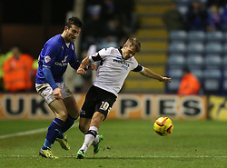 Leicester City's David Nugent and Derby County's Jamie Ward battle for the ball - Photo mandatory by-line: Matt Bunn/JMP - Tel: Mobile: 07966 386802 10/01/2014 - SPORT - FOOTBALL - King Power Stadium - Leicester - Leicester City v Derby County - Sky Bet Championship