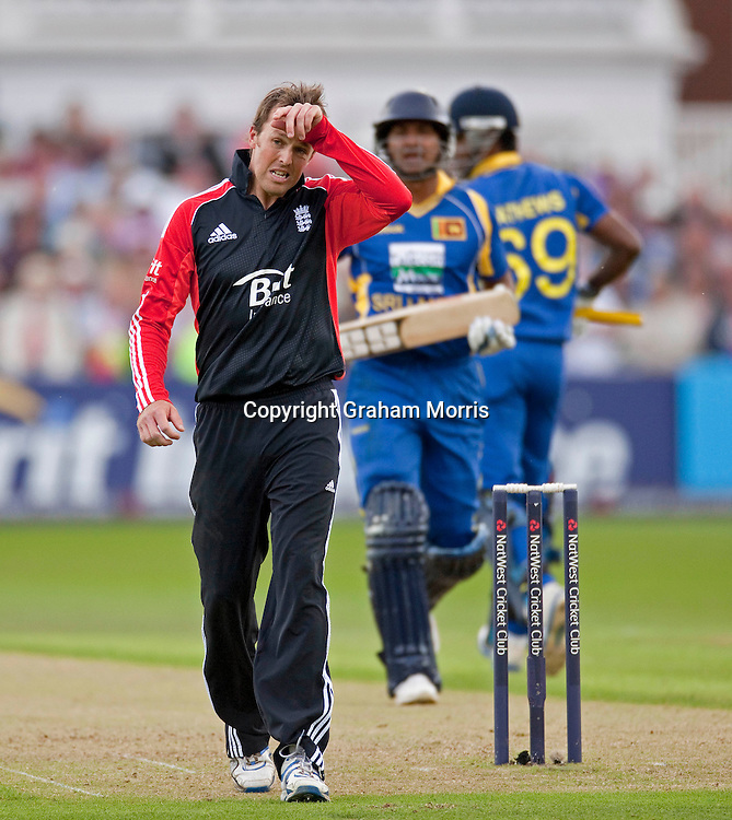 Bowler Graeme Swann finds it hard going during the fourth one day international between England and Sri Lanka at Trent Bridge, Nottingham. Photo: Graham Morris (Tel: +44(0)20 8969 4192 Email: sales@cricketpix.com) 06/07/11