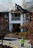 A fire official stands by as firefighters continue to pour water on hot spots Friday November 17, 2017 after a 5-alarm fire at Barclay Friends Nursing Home in West Chester, Pennsylvania. The fire has displaced at least 200 residents of the facility. (WILLIAM THOMAS CAIN/ For The Philadelphia Inquirer)