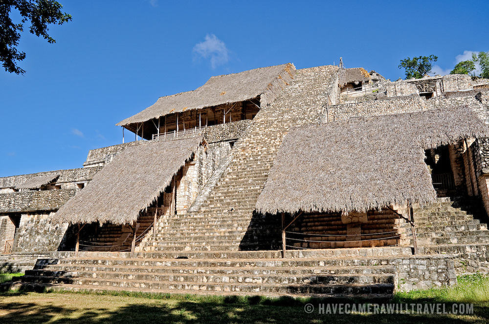 The Acropolis at the ancient Mayan ruins at Ek' Balam, near Valladolid, Yucatan, Mexico. The Acropolis is the largest structure at the site and incorporates the temple and royal palace. One can climb to the top up the 106 stone steps. The modern thatched roofs are to protect some extraordinarily well preserved and intricate carvings.