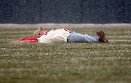 A fan ran onto the field to make a snow angel during a weather delay..Snow delayed the home opener of the Cleveland Indians/Seattle Mariners contest at Jacobs Field, April 6, 2007