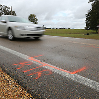 Orange paint marks the road where the rear tires of a school bus were located following the death of child that was struck my a motorist while trying to board the bus school along Hwy. 370 in Baldwyn Wednesday morning.