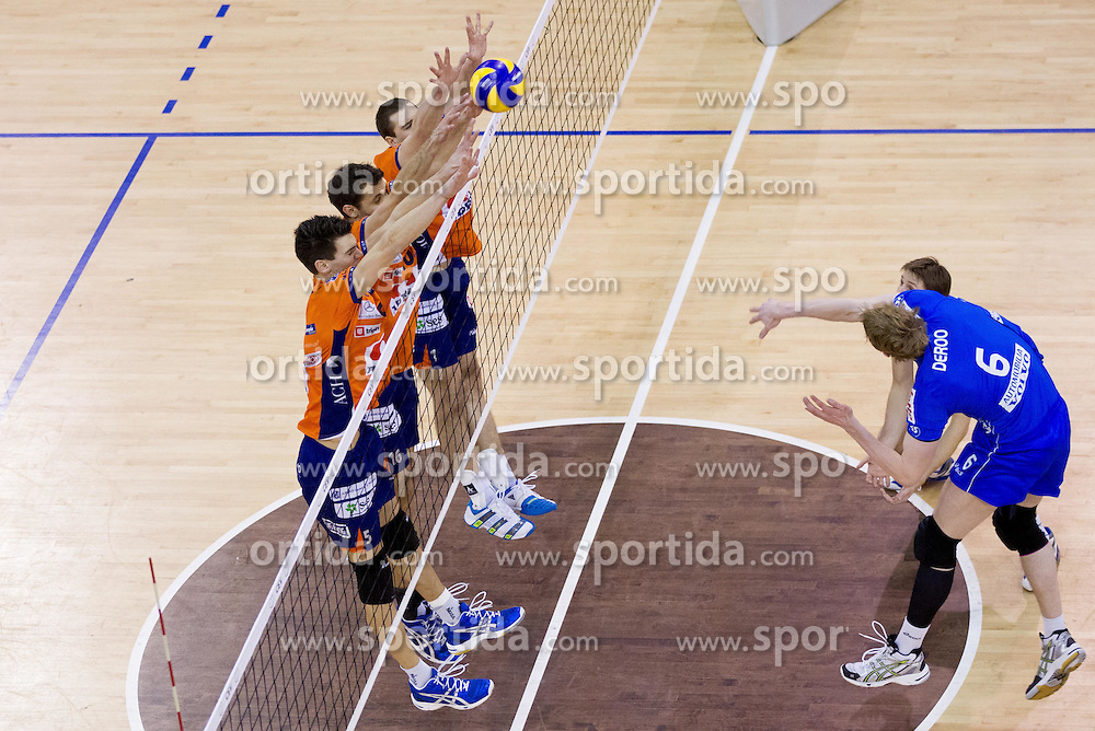 Alen Sket, Matej Vidic and Andrej Flajs of ACH in block vs Sam Deroo of Knack Roeselare during volleyball match between ACH Volley (SLO) and Knack Roeselare (BEL) at Quarterfinals of CEV Challenge Cup 2011/2012, on February 8, 2012 in Arena Tivoli, Ljubljana, Slovenia. ACH Volley defeated Knack Roeselare  3-0. (Photo By Vid Ponikvar / Sportida.com)