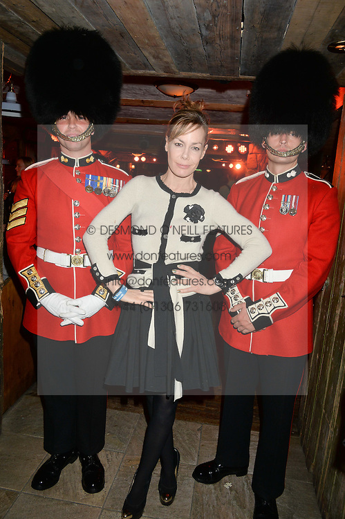 TARA PALMER-TOMKINSON and guardsmen at Skiing With Heroes Junior Committee Awareness Party held at Bodo's Schloss, 2A Kensington High Street, London on 6th November 2014.