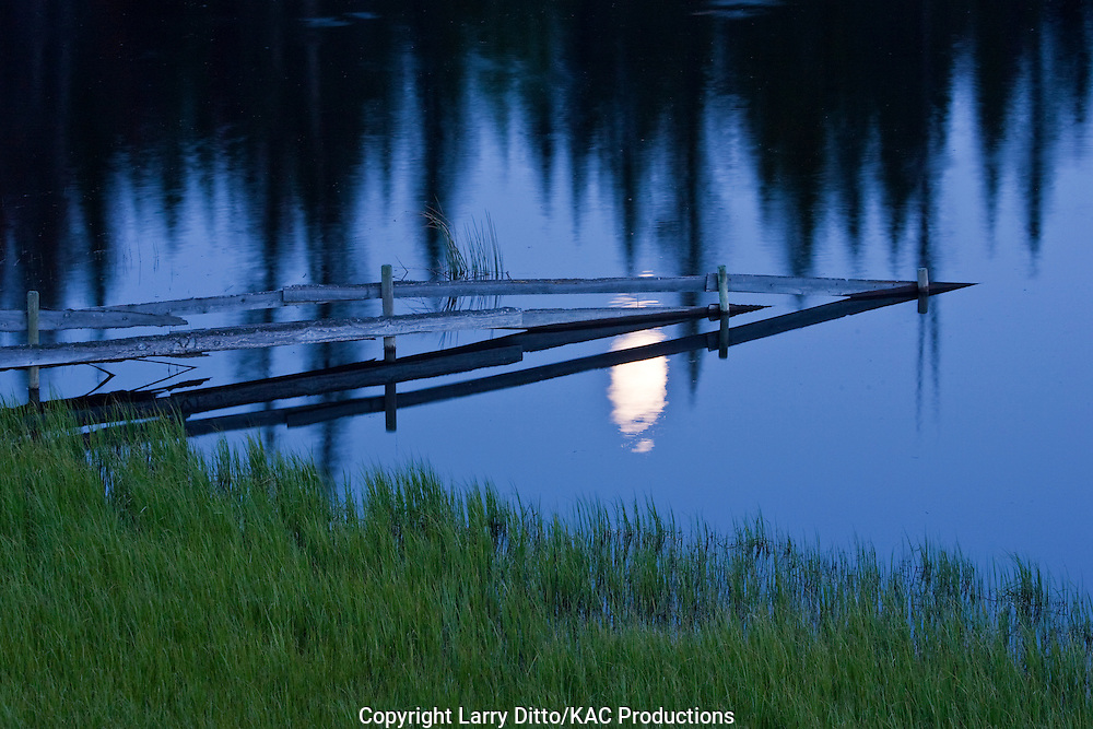 Moonrise over a British Columbia lake, Canada, June