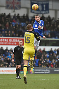 Ipswich Town striker Joe Garner (14) heads away from Burton Albion defender Tom Naylor (15) during the EFL Sky Bet Championship match between Ipswich Town and Burton Albion at Portman Road, Ipswich, England on 10 February 2018. Picture by Richard Holmes.