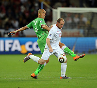 Wayne Rooney<br /> England World Cup 2010<br /> Madjid Bougherra Algeria<br /> England V Algeria 18/06/10 Group C at Durban<br /> FIFA World Cup 2010<br /> Photo Robin Parker Fotosports International