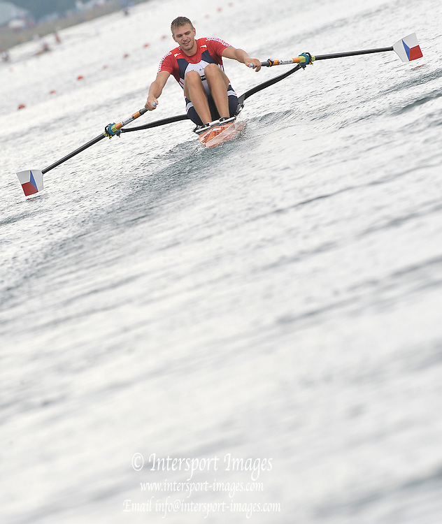 Munich GERMANY,   CZE M1X, Ondrej SYNEK, at the 2nd Round FISA World cup on the Olympic Rowing Course Munich, Friday 19/06/2009, [Mandatory Credit. Peter Spurrier/Intersport Images]
