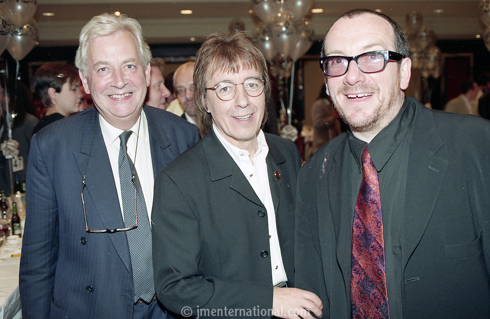 Andrew Miller, Bill Wyman, and Elvis Costello. The Silver Clef Awards 1997, The Intercontinental, London<br /> (Photo/John Marshall JME)