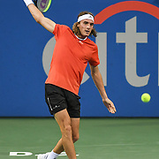 STEFANOS TSITSIPAS hits a backhand at the Rock Creek Tennis Center.