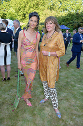 Left to right, MARCHIONESS OF WORCESTER and PENNY MORRISON at the Quintessentially Foundation and Elephant Family 's 'Travels to My Elephant' Royal Rickshaw Auction presented by Selfridges and hosted by HRH The Prince of Wales and The Duchess of Cornwall held at Lancaster House, Cleveland Row, St.James's, London on 30th June 2015.