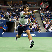August 29, 2017 - New York, NY : The Spanish tennis player Rafael Nadal, not visible, and Serbian player Dušan Lajović, pictured here, face off in Arthur Ashe Stadium on the second day of the U.S. Open, at the USTA Billie Jean King National Tennis Center in Queens, New York, on Tuesday afternoon. Nadal went on to defeat Lajović. <br /> CREDIT : Karsten Moran for The New York Times