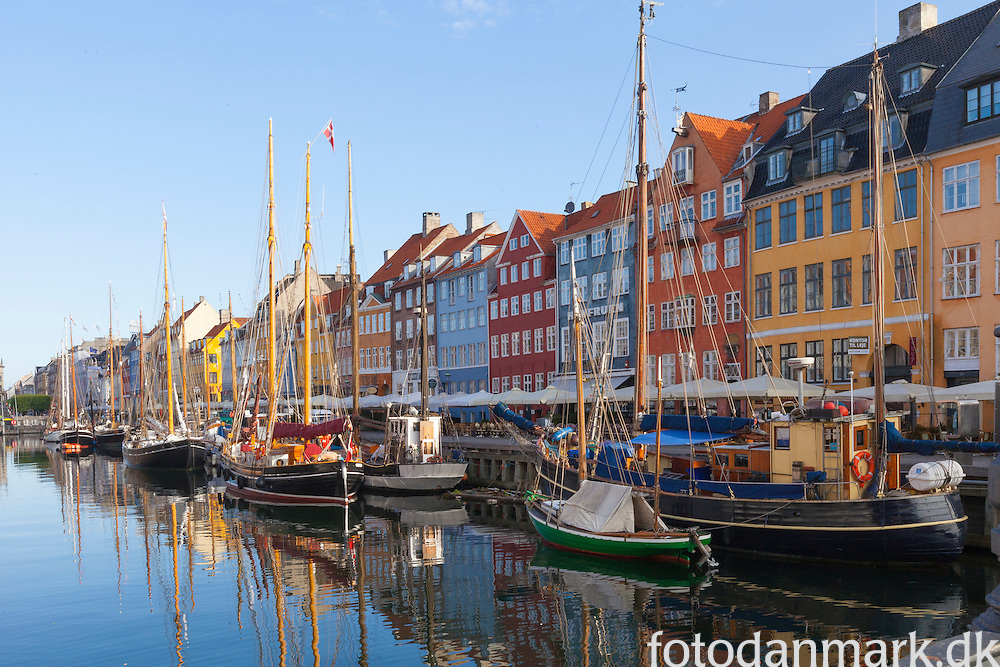 Nyhavn canal with old boats and ships along the quay