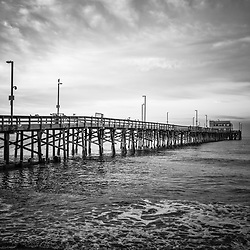 Newport Beach Pier Black and White Picture. Newport Pier  is located along the Pacific Ocean on Balboa Peninsula in Orange County Southern California. Image Copyright © Paul Velgos All Rights Reserved.