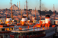 Bosporus ferries with Suleymaniye Mosque in background, Istanbul, Turkey