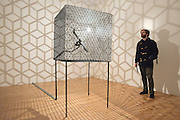 "© Licensed to London News Pictures. 29/01/2013. London, UK A man looks at Conrad Shawcross' ""Slow Arc inside a Cube iV (2009). Press preview of ""Light Show"" at the Hayward Gallery at the Southbank Centre in London today 29th January 2013. The exhibition runs 30th Jan-28th Apr 2013. Photo credit : Stephen Simpson/LNP"