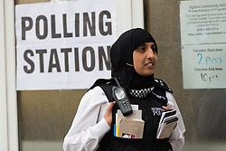***LNP HIGHLIGHTS OF THE WEEK ***  © Licensed to London News Pictures. 22/05/2014. London, UK. Police officers stand outside a polling station at the Ogilvie Community Hall in Shadwell, East London on 22 May 2014.  All polling stations in Tower Hamlets today have a police presence to protect voters from any intimidation. Photo credit : Vickie Flores/LNP
