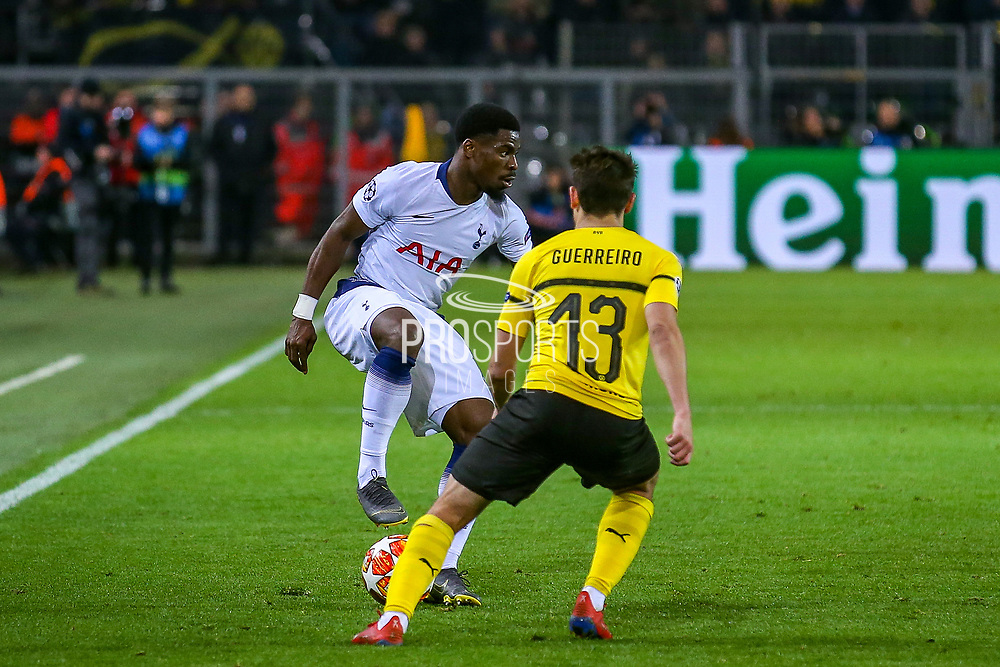 Tottenham Hotspur defender Serge Aurier (24) shields the ball from Borussia Dortmund defender Raphaël Guerreiro (13) during the Champions League round of 16, leg 2 of 2 match between Borussia Dortmund and Tottenham Hotspur at Signal Iduna Park, Dortmund, Germany on 5 March 2019.