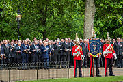 The service at the bandstand - The Combined Cavalry OCA Parade, Hyde Park. More than two thousand cavalrymen march in a mixture of uniforms or suits with bowler hats (for officers only) and furled umbrellas creating a quintessentially British scene. It is the 93rd Annual Parade and Service of The Combined Cavalry Old Comrades Association at the Cavalry Memorial adjacent and the Bandstand in Hyde Park. Field Marshal Baron Guthrie GCB, LVO, OBE, DL Colonel The Life Guards and Gold Stick took the salute at the march past for both serving and former soldiers of all the Regiments of Regular Cavalry and many Yeomanry Regiments.