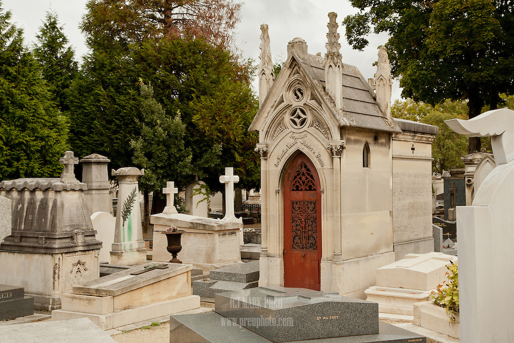 A small sample of the variety of grave markers in the Montparnasse Cemetery in Paris.