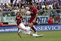 Livorno 17-4-05<br />Livorno Fiorentina Campionato serie A 2004-05<br />nella  foto Cristiano Lucarelli contro Dainelli<br />Foto Snapshot / Graffiti
