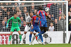Crystal Palace's Mamadou Sakho (right) receives the ball during the Premier League match at Selhurst Park, London.