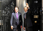© licensed to London News Pictures. LONDON, UK  25/05/11. Barack Obama and David Cameron wave to the media as they meet in Downing Street during US President Obama's first State Visit to the United Kingdom. Please see special instructions. Photo credit should read Stephen Simpson/LNP