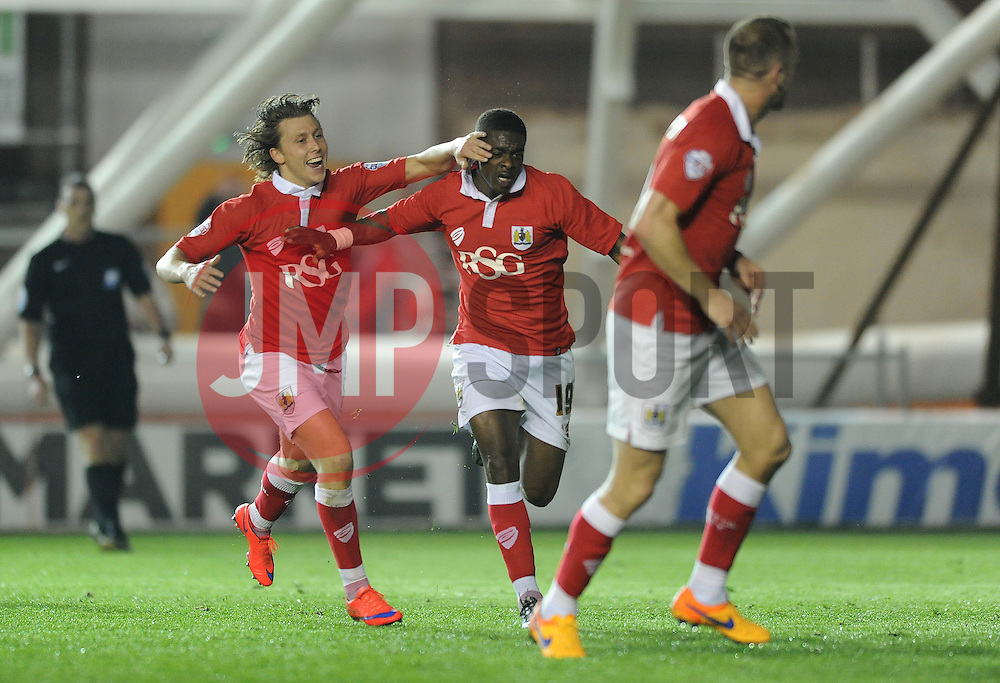Bristol City's Kieran Agard celebrates his goal with Bristol City's Luke Freeman - Photo mandatory by-line: Dougie Allward/JMP - Mobile: 07966 386802 - 07/04/2015 - SPORT - Football - Bristol - Ashton Gate - Bristol City v Swindon Town - Sky Bet League One
