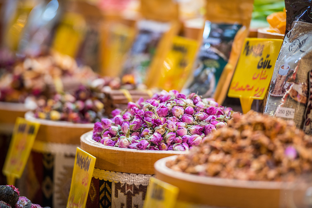 Bright-pink tea flowers fill wooden basket at Istanbul Spice bazaar in Turkey