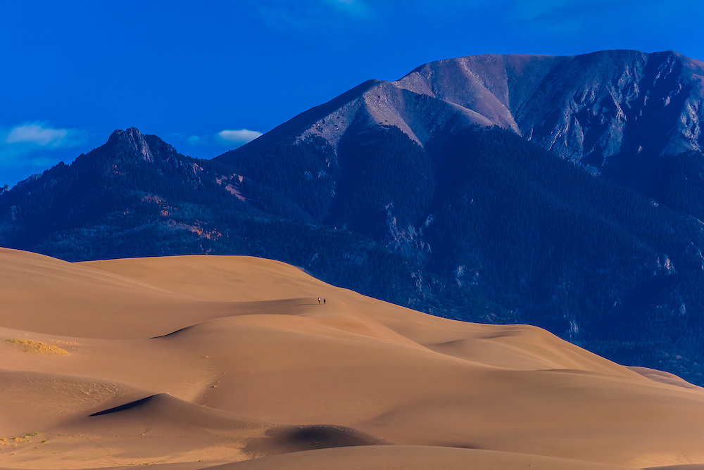 The Great Sand Dunes with the Sangre de Cristo Mountains behind, Great Sand Dunes National Park and Preserve, near Mosca, Colorado USA. The park contains the tallest sand dunes in North America, rising about 750 feet above the floor of the San Luis Valley.