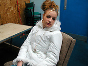 Girl wearing a white coat and a chain with the letter 'D'