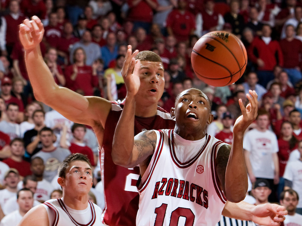 FAYETTEVILLE, AR - DECEMBER 30:   Marcus Monk #10 of the Arkansas Razorbacks gets a rebound in front of Blake Griffin #23 of the Oklahoma Sooners at Bud Walton Arena on December 30, 2008 in Fayetteville, Arkansas.  The Razorbacks defeated the Sooners 96-88.  (Photo by Wesley Hitt/Getty Images) *** Local Caption *** Marcus Monk; Blake GriffinUniversity of Arkansas Razorback Men's and Women's athletes action photos during the 2008-2009 season in Fayetteville, Arkansas....©Wesley Hitt.All Rights Reserved.501-258-0920.