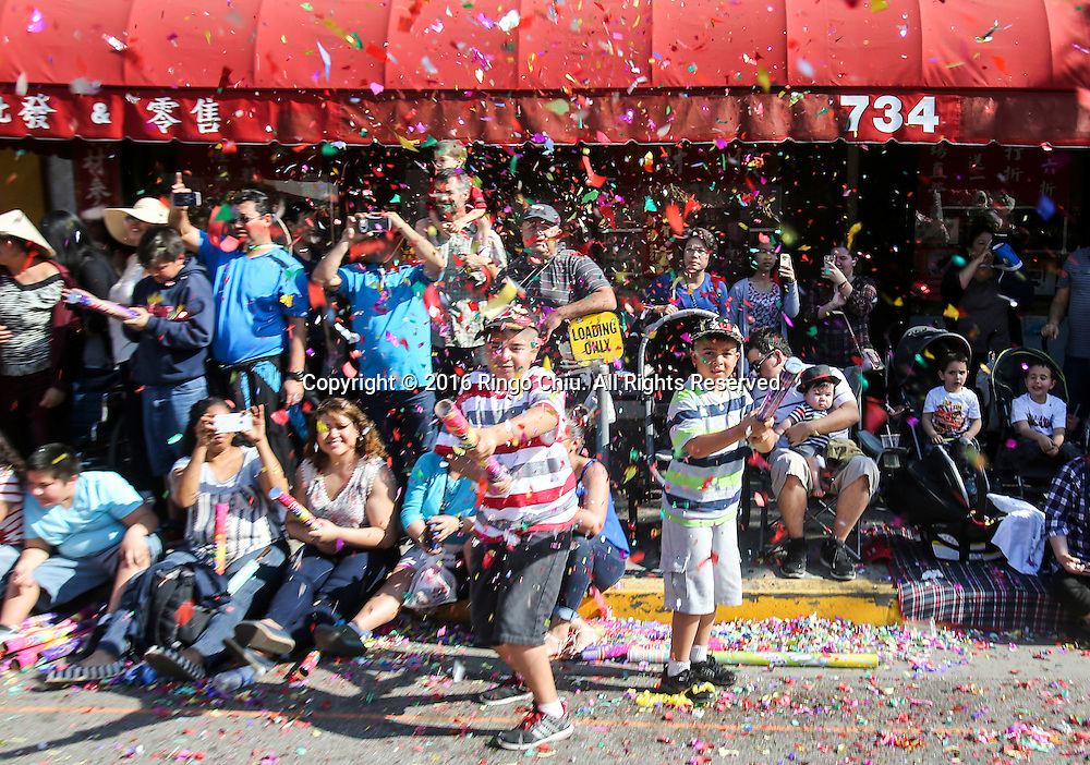 Children fire confetti in the 117th annual Chinese New Year &quot;Golden Dragon Parade&quot; in the streets of Chinatown in Los Angeles, Saturday Feb. 13, 2016. (Photo by Ringo Chiu/PHOTOFORMULA.com)<br /> <br /> Usage Notes: This content is intended for editorial use only. For other uses, additional clearances may be required.
