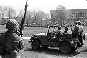 705/4-4 (28)... Guardsmen watch from a distance as students gather in the commons late in the morning of May 4, 1970.