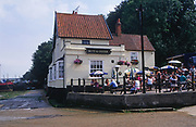 A088YF Butt and Oyster pub with lunchtime crowd outside Pin Mill  River Orwell Suffolk England
