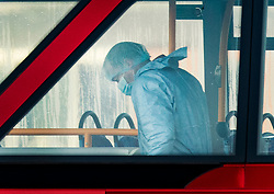 © Licensed to London News Pictures. 30/11/2019. London, UK. A police forensics officer works on the top deck of a London bus on London Bridge the day after the terrorist attack. Two people were killed and three injured after the attacker, named by police as 28-year-old Usman Khan stabbed a man and a woman to death on London Bridge. Photo credit: Peter Macdiarmid/LNP